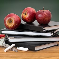 image of apples on books
