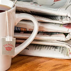 image of mug and newspapers