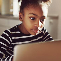 Young-African-American-female-student-looking-at-a-laptop-computer-770×370-1